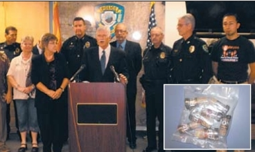 Pinal County Attorney James P. Walsh (at podium), backed by representatives of  law enforcement and anti-drug groups from throughout the county, detailed a new  initiative to halt availability of synthetic drugs disguised in colorful packaging as  bath salts, incense and spices (see inset).